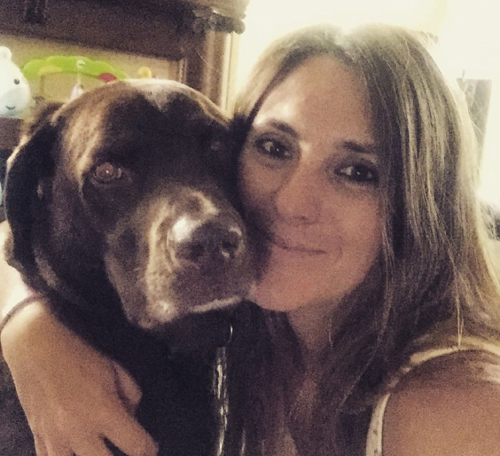 Lisa McCombs with her service dog, Jake.