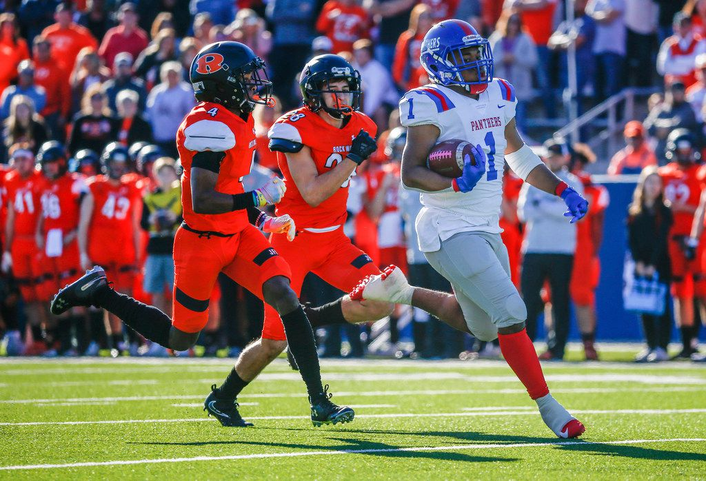 Duncanville running back Trysten Smith (1) breaks away from Rockwall defensive back Cyvon Cezar (4) and defensive back Jackson Gillock (28) for a touchdown during the first half of a Class 6A Division I state semifinal football matchup between Rockwall and Duncanville on Saturday, Dec. 14, 2019 at McKinney ISD Stadium in McKinney, Texas. (Ryan Michalesko/The Dallas Morning News)