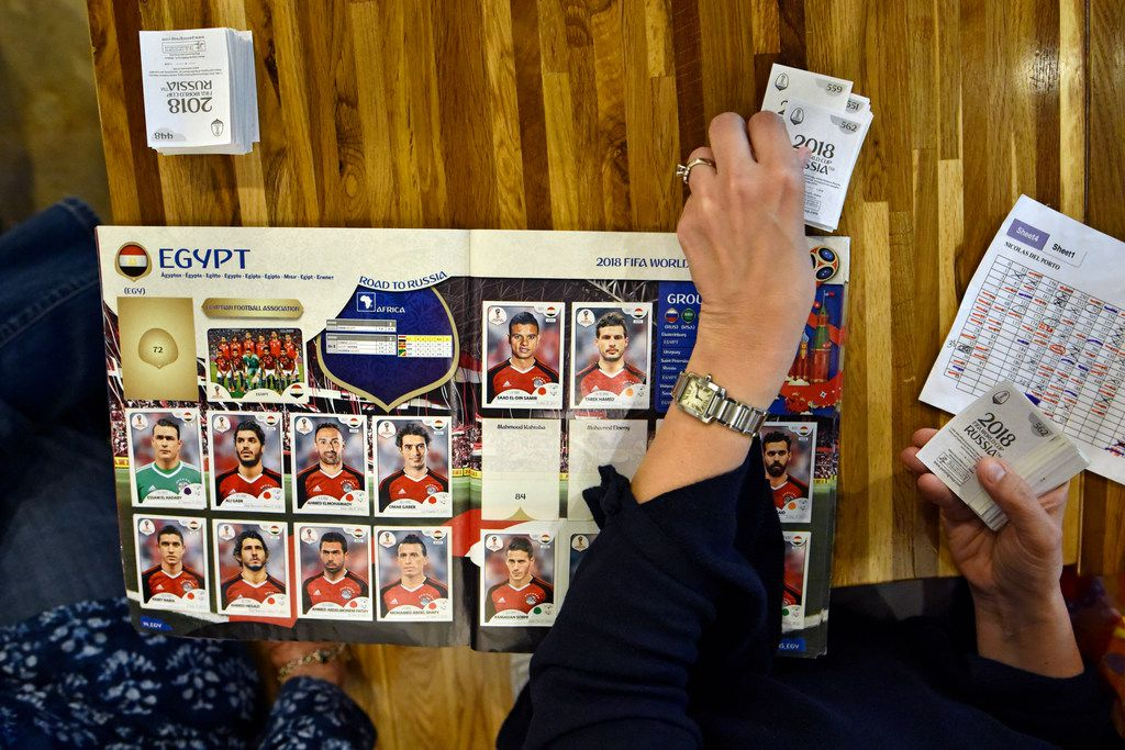 A woman searches stickers for soccer players for Egypt during a Panini World Cup sticker album interchange event at the restaurant Arepa TX in Dallas, April 20, 2018. Ben Torres/Special Contributor