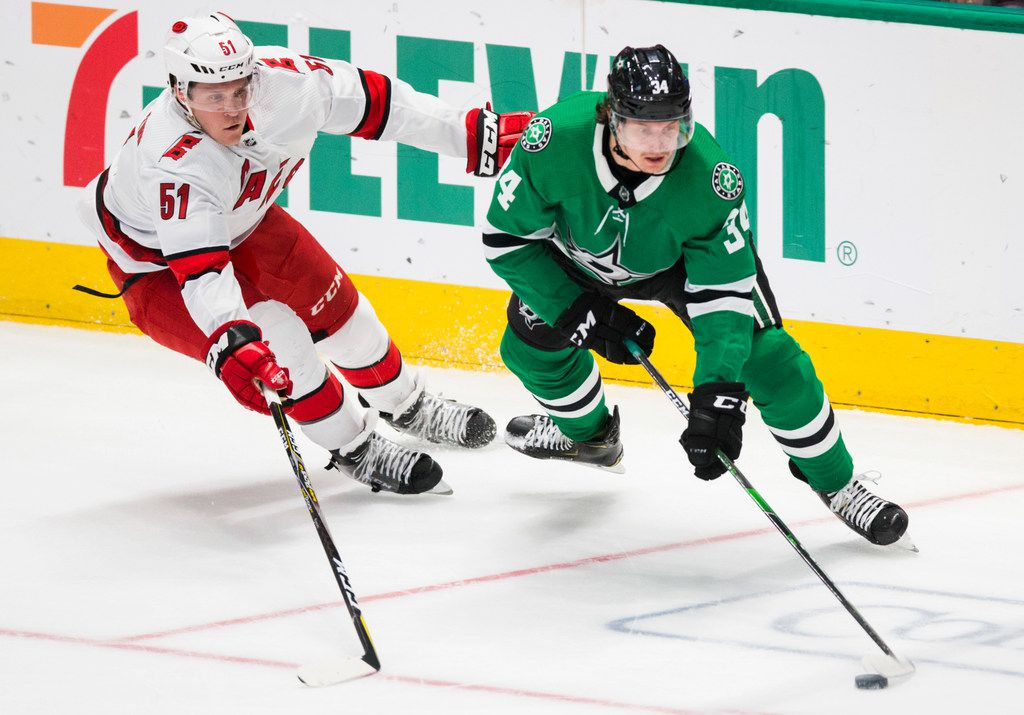 Dallas Stars right wing Denis Gurianov (34) gets ahead of Carolina Hurricanes defenseman Jake Gardiner (51) during the second period of an NHL game between the Dallas Stars and the Carolina Hurricanes on Tuesday, February 11, 2020 at American Airlines Center in Dallas. (Ashley Landis/The Dallas Morning News)