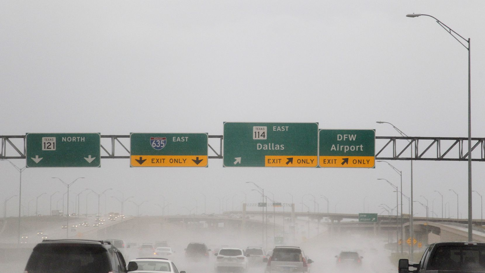 The traffic on Texas State Highway 114 east bound before DFW Airport in Grapevine, TX during the rain on June 9, 2014.  (Kye R. Lee / The Dallas Morning News)