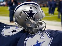 A Cowboys helmet is pictured on the bench before a game against the Bears at Soldier Field on Thursday, Dec. 5, 2019, in Chicago.