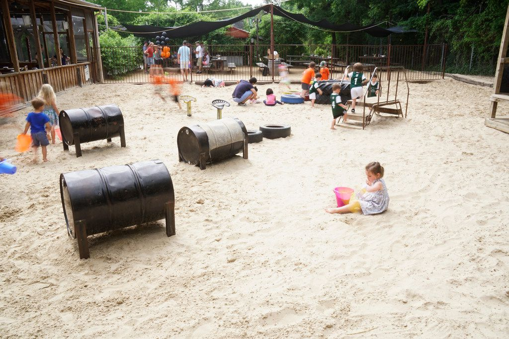 Children play while their parents enjoy food and drinks at The Lot in Dallas, Texas on Saturday May 19, 2018.