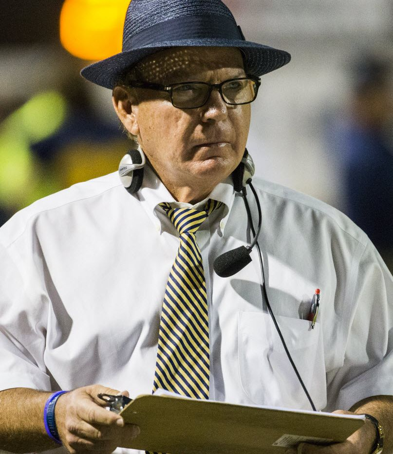 Highland Park head coach Randy Allen checks his clipboard during the first quarter of their game against Mesquite Horn on Friday, October 9, 2015 at Highlander Stadium in University Park, TX.   (Ashley Landis/The Dallas Morning News)