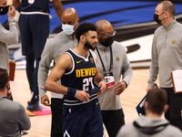Denver Nuggets guard Jamal Murray (27) is escorted off the court after getting ejected in a game against the Dallas Mavericks during the third quarter of play at American Airlines Center on Monday, January 25, 2021in Dallas.