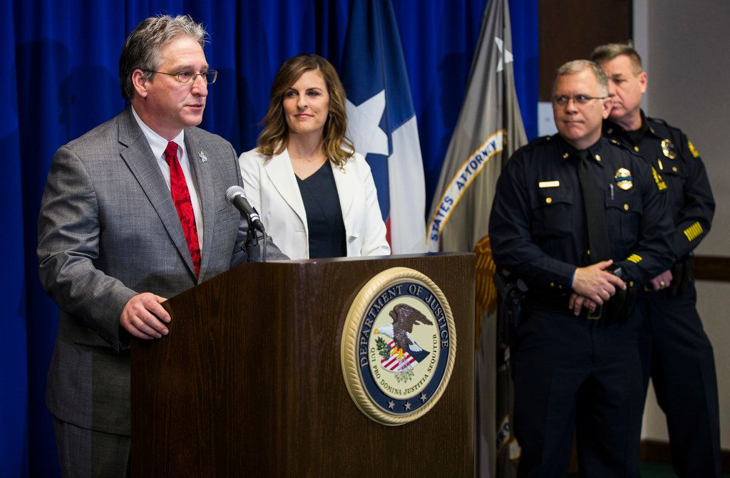 Texas Anti-Gang Center Administrator Todd Reichert, left, speaks at a press conference where U.S. Attorney Erin Nealy Cox announced federal charges against 57 white supremacist gang members on Monday, April 30, 2018 at the Earle Cabell Federal Building in Dallas.