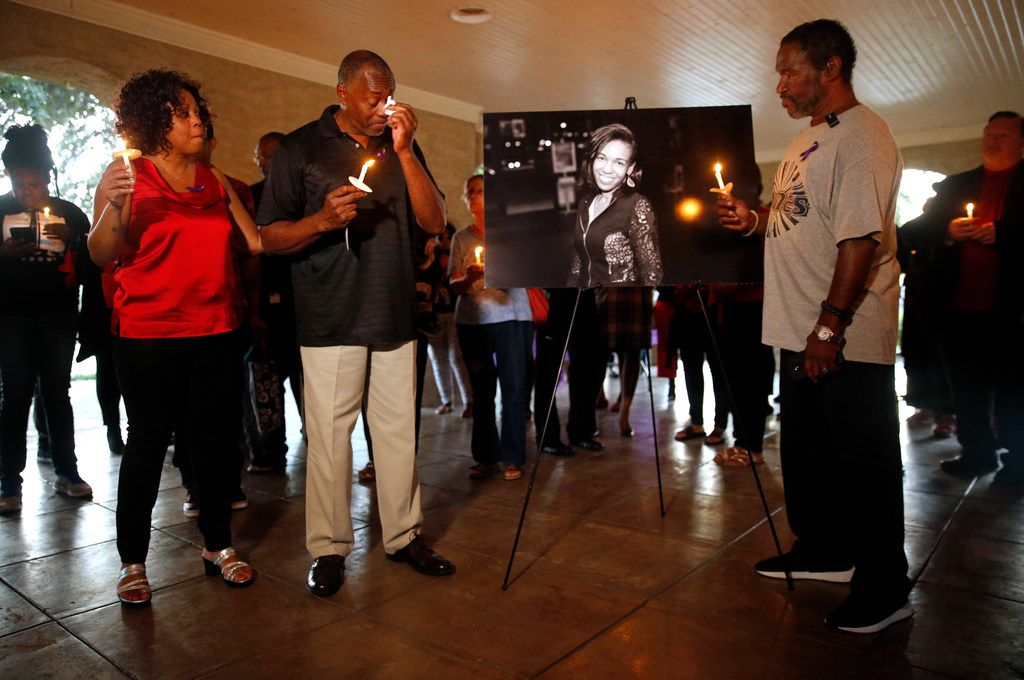 Donna Alexander's step-father Larry Armour of Little Rock, Arkansas (center, left) wipes away tears as he and her father Donald Alexander (right) of Pleasanton, New Jersey paid respects to their daughter during a vigil, Monday, October 1, 2018 at Cole Park in the Uptown area of Dallas. Her estranged boyfriend Nathaniel Mitchell, 34, was charged with murder after Alexander died a week after being beaten. Alexander was founder of the Deep Ellum's Anger Room, a warehouse designed to help people cope with stress. (Tom Fox/The Dallas Morning News)