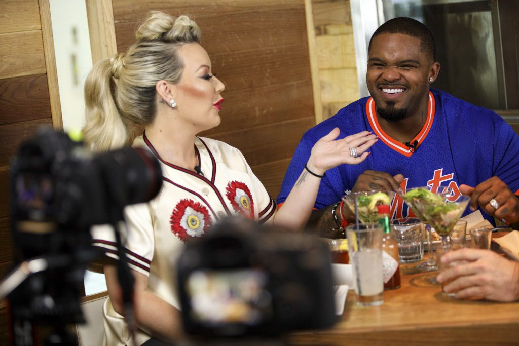 """Prince Fielder laughs with wife Chanel Fielder during filming of his show """"Fielder's Choice"""" at EMC Seafood and Raw Bar on Monday, June 19, 2017 in Los Angeles, Calif. In July, 2016, professional MLB baseball player Prince Fielder got an unexpected and shocking diagnosis - he had suffered a second herniation of a disc and that his baseball career was over. He is now working on a food and cooking show """"Fielders Choice"""" and pursuing an acting career in his retirement from the Texas Rangers team. (Photo by Patrick T. Fallon/Special Contributor to The Dallas Morning News)"""