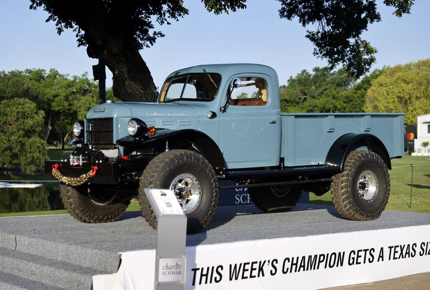 The 1946 Schwab Power Wagon is on display near the 10th tee box during the Charles Schwab Challenge Colonial Pro-Am at the Colonial Country Club in Fort Worth, Wednesday, May 26, 2021. The winner of the tournament will win the custom-built rugged truck. (Tom Fox/The Dallas Morning News)