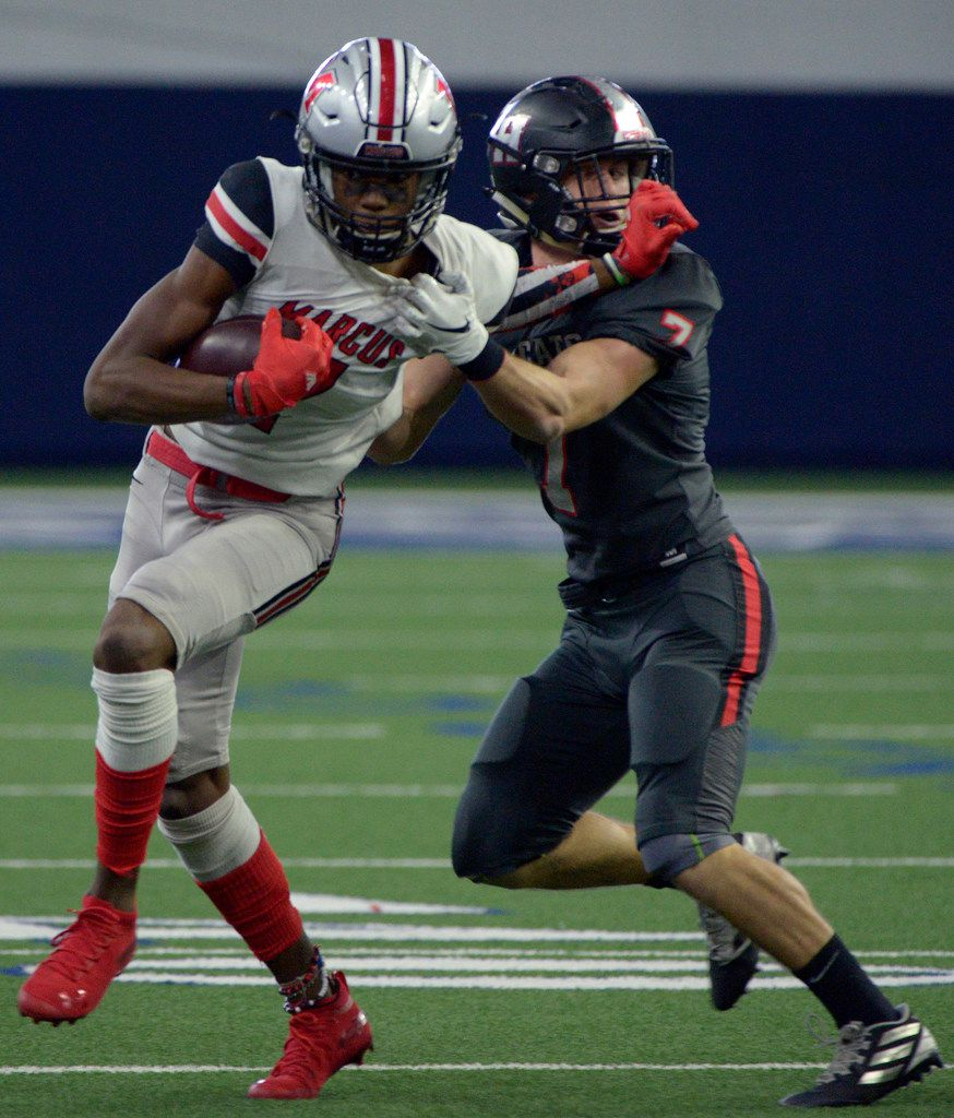 Flower Mound Marcus' J. Michael Sturdivant stiff arms Lake Highlands Caleb Parker (7) in the first half of a Class 6A Division II area round high school playoff football game between Flower Mound Marcus and Lake Highlands, Saturday, Nov. 23, 2019, in Frisco, Texas. (Matt Strasen/Special Contributor)