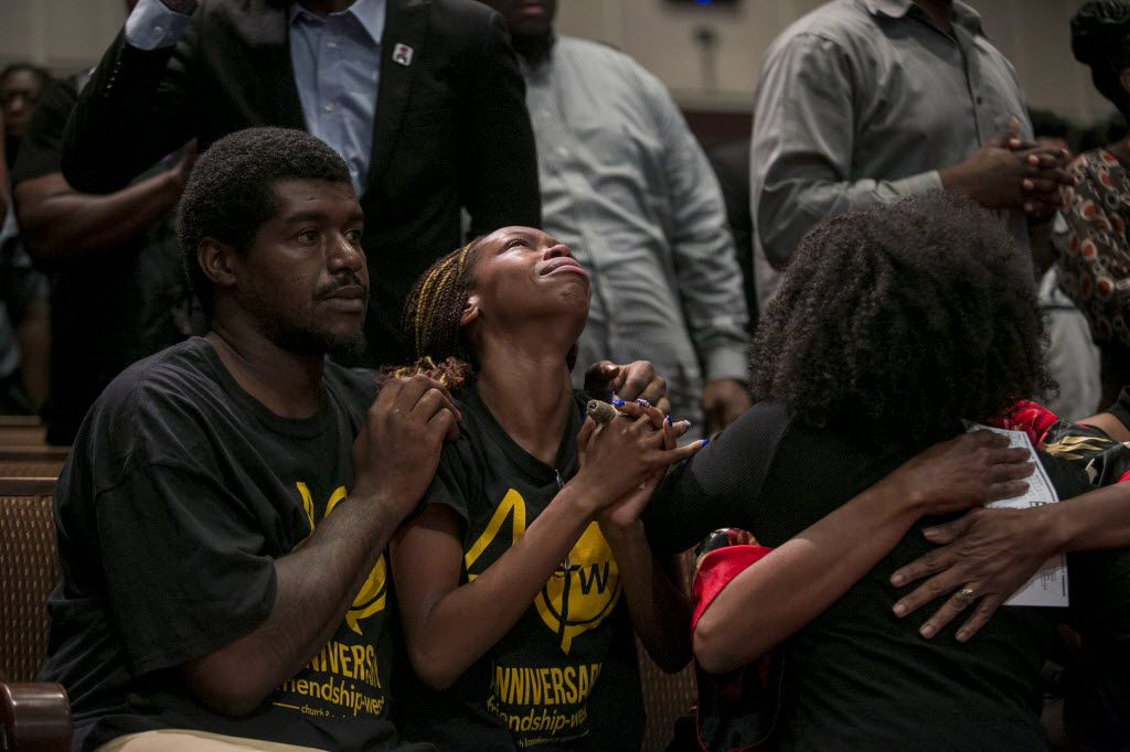 People pray during a service at Friendship-West Baptist Church in Dallas, July 10, 2016. The service largely focused on the two black men killed by police in Minnesota and Louisiana last week, along with the five police officers killed in Dallas. (Ilana Panich-Linsman/The New York Times