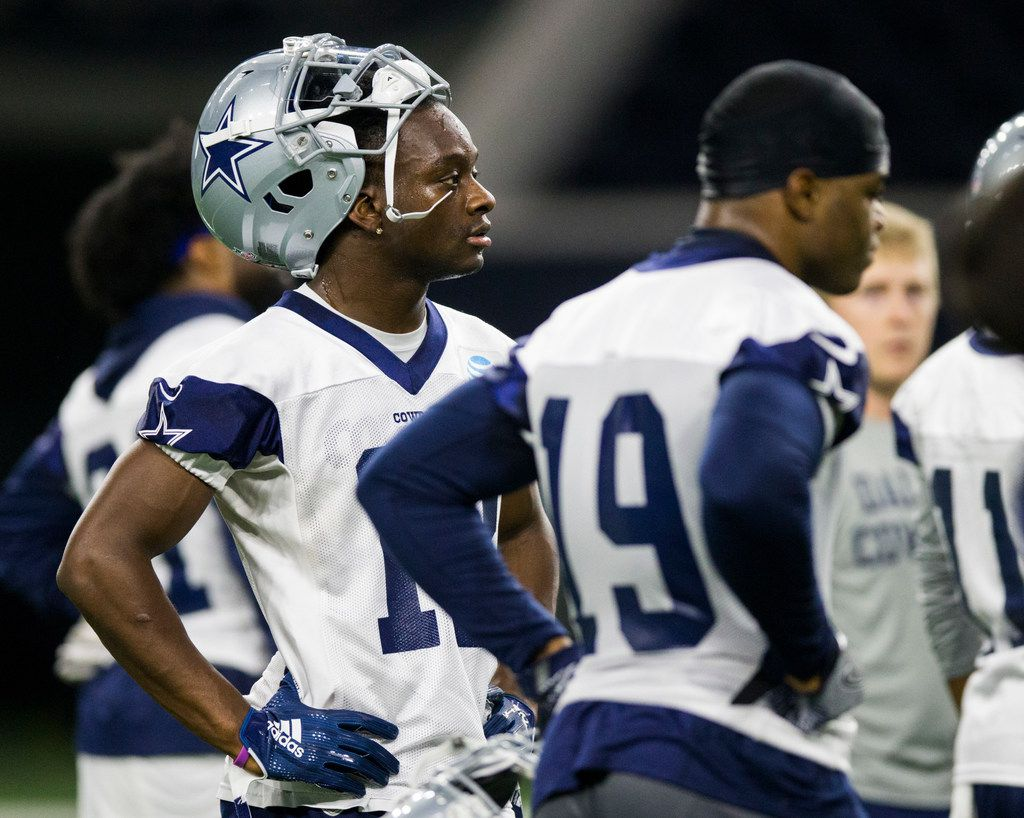 Dallas Cowboys wide receiver Michael Gallup (13) stands with wide receiver Amari Cooper (19) during a Dallas Cowboys OTA practice on Wednesday, May 29, 2019 at The Star in Frisco. (Ashley Landis/The Dallas Morning News)