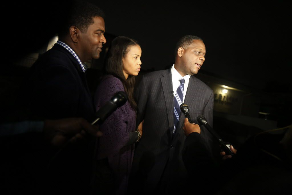 Democrat Craig Watkins (far right) was joined by his wife, Tanya, and then-First Assistant District Attorney Heath Harris as he gave  his concession speech after losing the 2014 district attorney election.