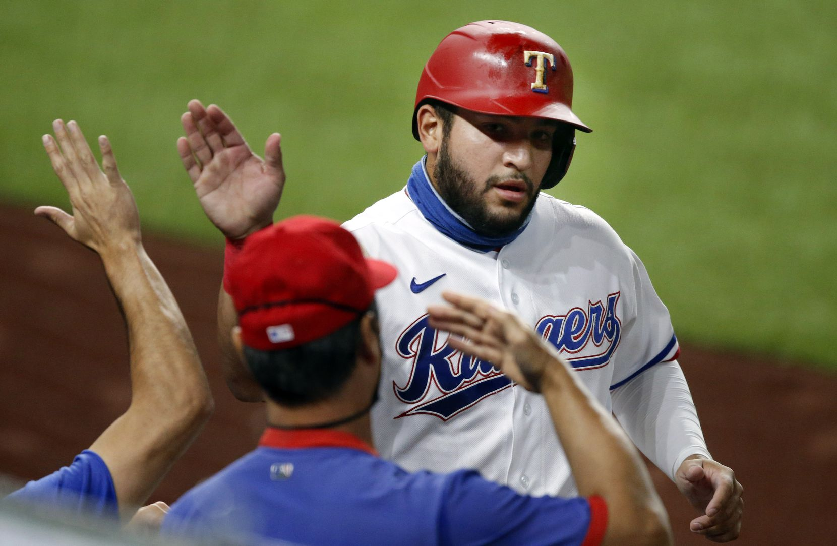 Texas Rangers Jose Trevino (56) is congratulated on his run during the second inning against the Oakland Athletics at Globe Life Field in Arlington, Texas,Tuesday, August 25, 2020. He scored on a single by Texas Rangers Isiah Kiner-Falefa (9). (Tom Fox/The Dallas Morning News)