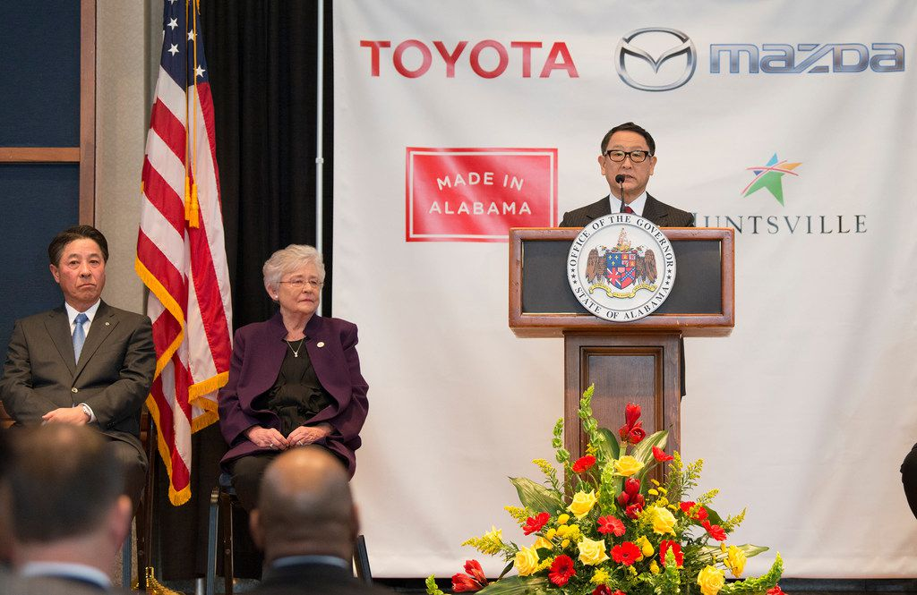 Akio Toyoda, right, Toyota Motor Corp., speaks as Alabama Gov. Kay Ivey, center, Masamichi Kogai, Mazda Motor Corp. president and CEO,  listen during a press conference, Wednesday, Jan. 10, 2018, in Montgomery, Ala., where the Japanese automakers announced plans to build a huge $1.6 billion joint-venture plant in Huntsville, that will eventually employ about 4,000 people. Several states had competed for the coveted project, which will be able to turn out 300,000 vehicles per year and will produce the Toyota Corolla compact car for North America and a new small SUV from Mazda.  (Albert Cesare/The Montgomery Advertiser via AP)