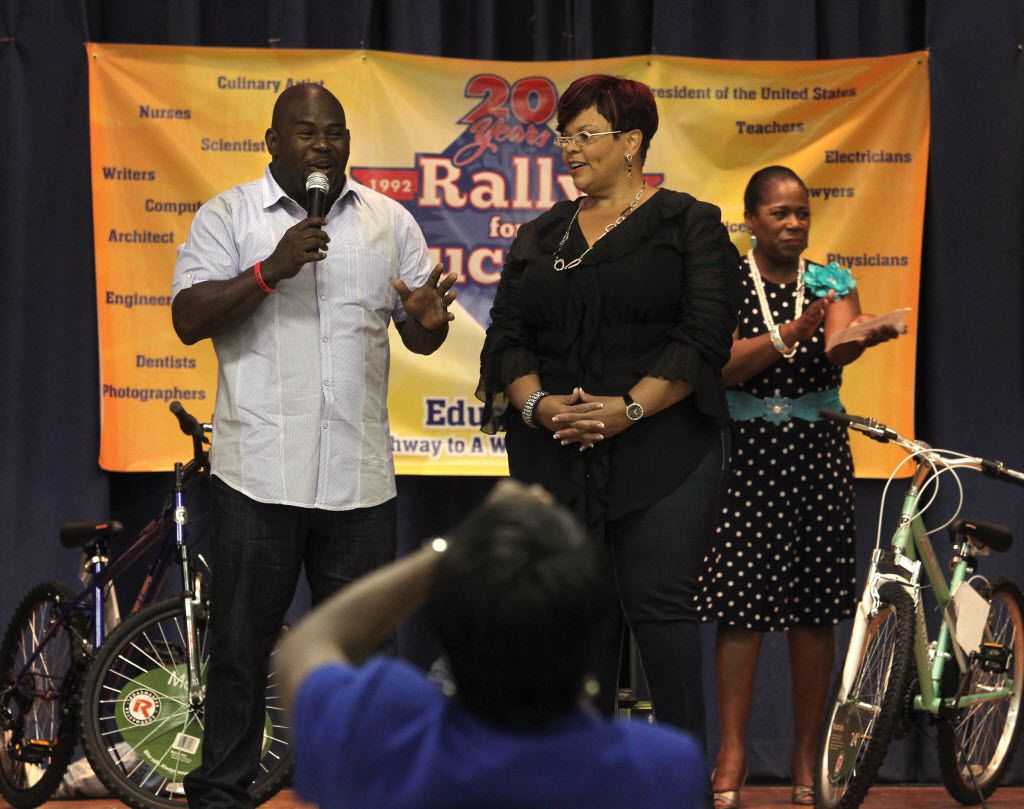 """David and Tamela Mann, Mr. Brown and Cora Simmons on the TBS television show, """"Meet the Browns,"""" speak to participants at the 2012 Rally for Education at the Dunbar Sixth Grade Center in Fort Worth, Texas on June 8, 2012. The rally celebrates its 20th year and is the product of organizer of Attorney Bobbie Edmonds, back right."""