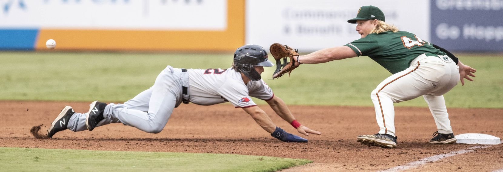 Hickory Crawdad's Josh H. Smith (12)gets back to first base during the game with the Greensboro Grasshopper's at First National Bank Field on Friday, August 6, 2021 in Greensboro, N.C. (Woody Marshall/Special Contributor)