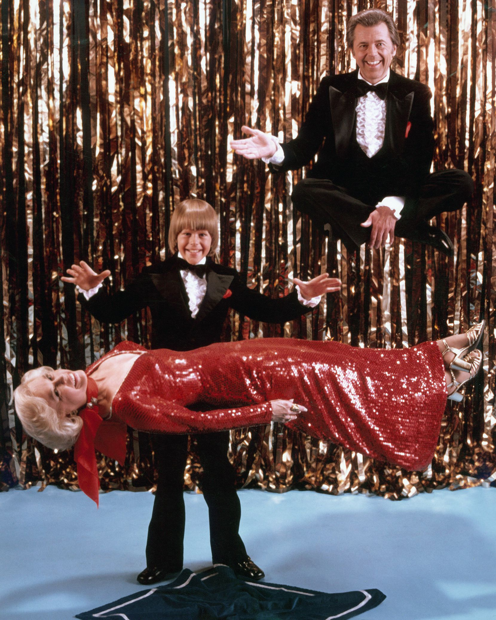 """Magician Mark Wilson, wife and co-star Nani Darnell, and their son Greg Wilson, in a photo titled """"Family Levitation,"""" taken in 1977."""