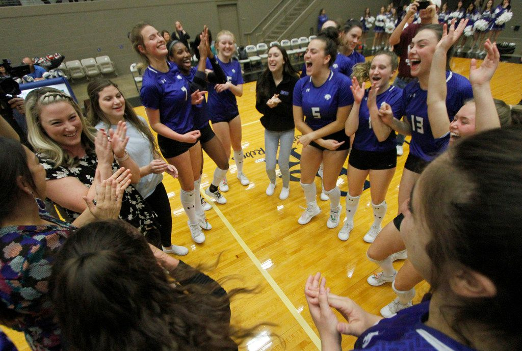 Trophy Club Byron Nelson head volleyball coach Brianne Barker-Groth, far left, celebrates with her Lady Bobcats players after they defeated Denton Guyer in straight sets to advance to the state tournament. The two teams played their Class 6A Region l championship volleyball match at W.G. Thomas Coliseum in Haltom City on November 16, 2019. (Steve Hamm/ Special Contributor)