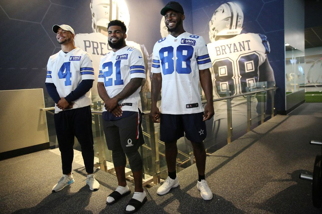 (From left) Dallas Cowboys quarterback Dak Prescott, running back Ezekiel Elliott and wide receiver Dez Bryant stand for a photo opportunity during a media tour of Cowboys Fit at The Star in Frisco, Texas Thursday May 18, 2017. The tour of the health and fitness center included a ribbon cutting with the Jeff Cheney, mayor of Frisco, Dallas Cowboys leadership, Mark Mastrov, founder of 24 Hour Fitness and chairman of New Evolution Ventures, and Mike Feeney, founder of New Evolution Ventures. The amenities at Cowboys Fit include class in three separate studios, rooftop deck and pool overlooking the Cowboys practice fields, health and nutrition bar, cryotherapy, 40-yard indoor fitness turf and an extensive exercise floor. (Andy Jacobsohn/The Dallas Morning News)