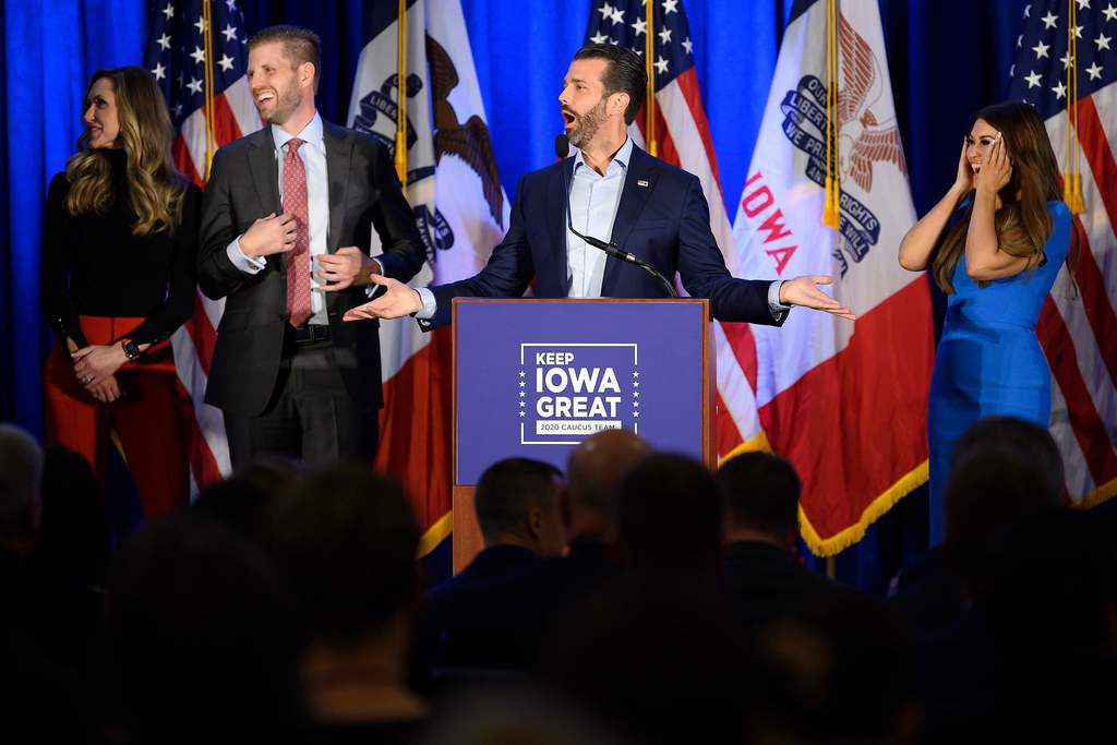 """Donald Trump Jr. (C) speaks with his brother Eric (2nd L) and wife Lara, as well as his girlfriend Kimberly Guilfoyle (R) during a """"Keep Iowa Great"""" press conference in Des Moines, IA, on February 3, 2020. (Photo by JIM WATSON / AFP) (Photo by JIM WATSON/AFP via Getty Images)"""