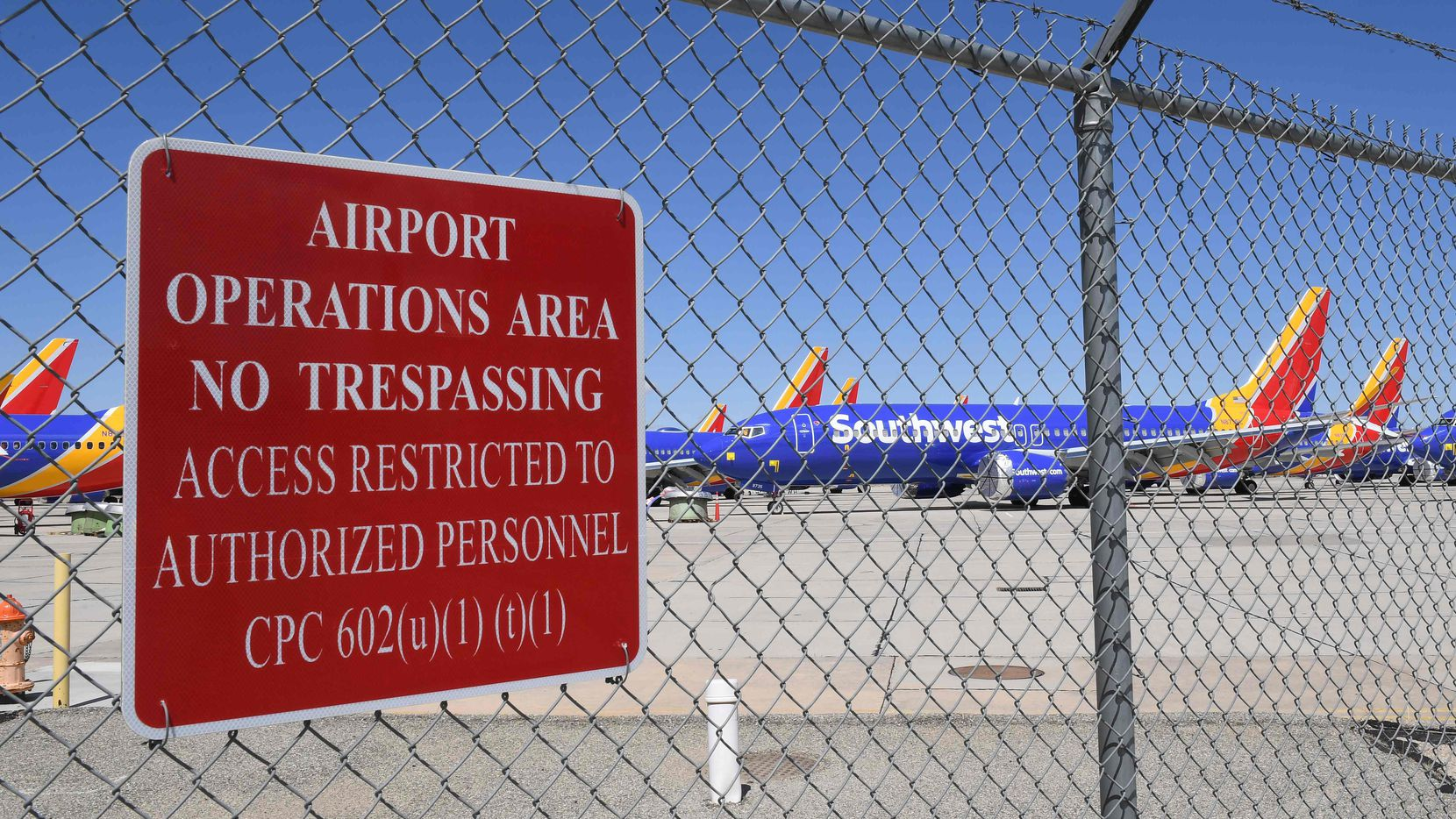 Southwest Airlines' Boeing 737 MAX aircrafts are parked on the tarmac at the Southern California Logistics Airport in Victorville, California on March 28, 2019. U.S. aircraft maker Boeing unveiled an upgraded for the MCAS flight software that originally grounded the aircrafts following two crashes in which nearly 350 people died. Boeing is responding to safety concerns about its top-selling plane, and after hundreds of hours of testing will roll out the fix to the stall-prevention software, once it's been approved by the Federal Aviation Administration. (Photo by Mark RALSTON / AFP)MARK RALSTON/AFP/Getty Images