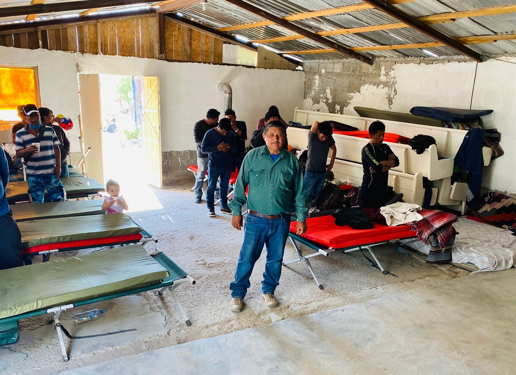 Pastor Jose Medrano stands inside his shelter-turned-ministry, Casa de Oracion El Peregrino on April 27 in Ojinaga, Chihuahua, across from Presidio, Texas. The shelter serves migrants from Central America.