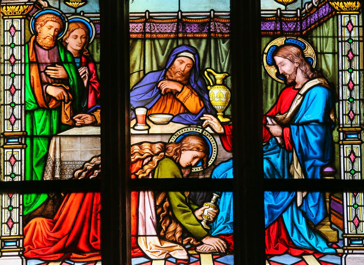 Stained Glass window in St. Vitus Cathedral, Prague, depicting Mary Magdalen anointing Christ's feet