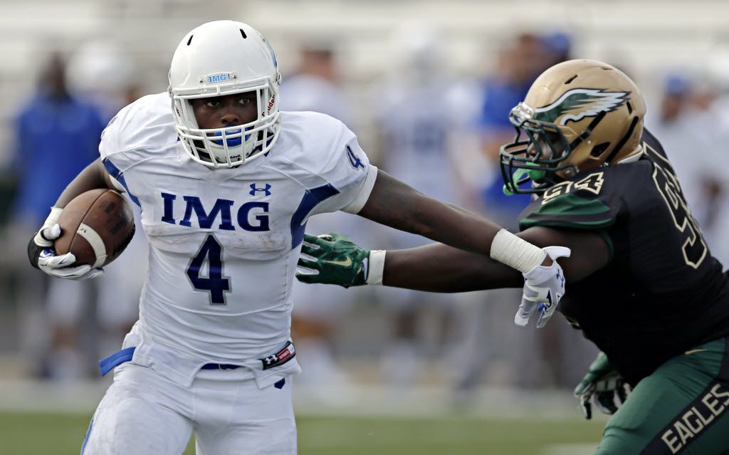 IMG's Tony Jones brushes off a tackle attempt by DeSoto's Curdarence Chambers during the second half of the Eagles' 47-29 loss Saturday, September 5, 2015 at Eagle Stadium in DeSoto, Texas. (G.J. McCarthy/The Dallas Morning News)