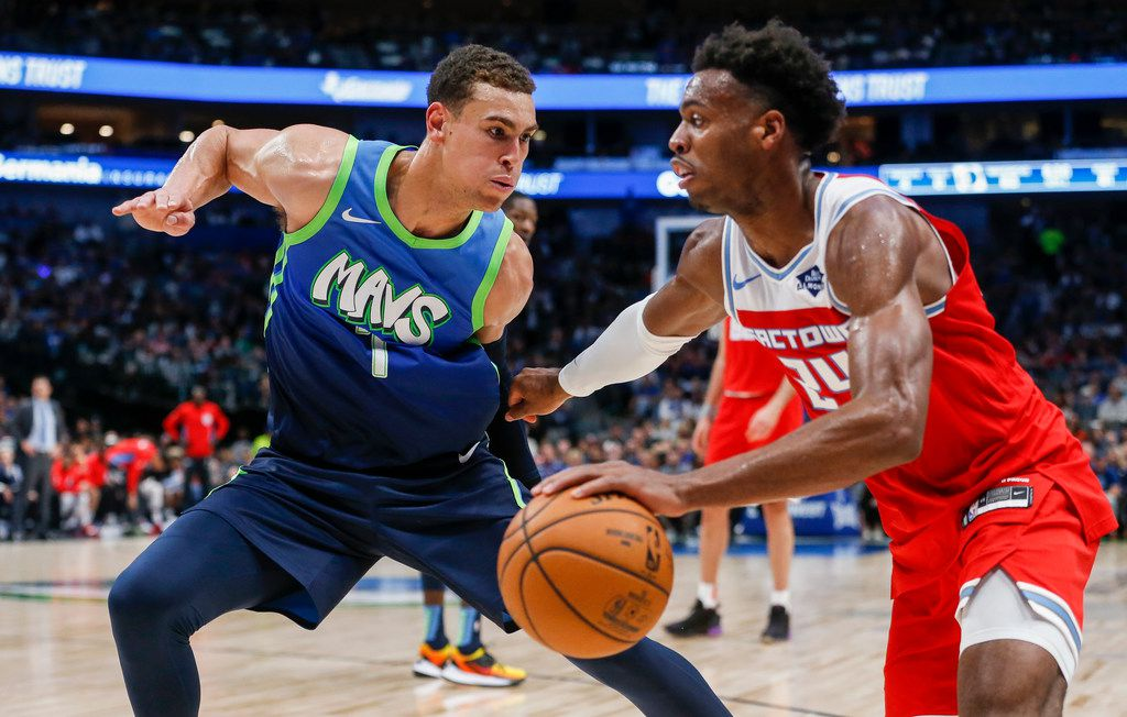 Sacramento Kings guard Buddy Hield (24) drives past Dallas Mavericks forward Dwight Powell (7) during the second half of a NBA matchup between the Dallas Mavericks and the Sacramento Kings on Sunday, Dec. 8, 2019 at American Airlines Center in Dallas. (Ryan Michalesko/The Dallas Morning News)