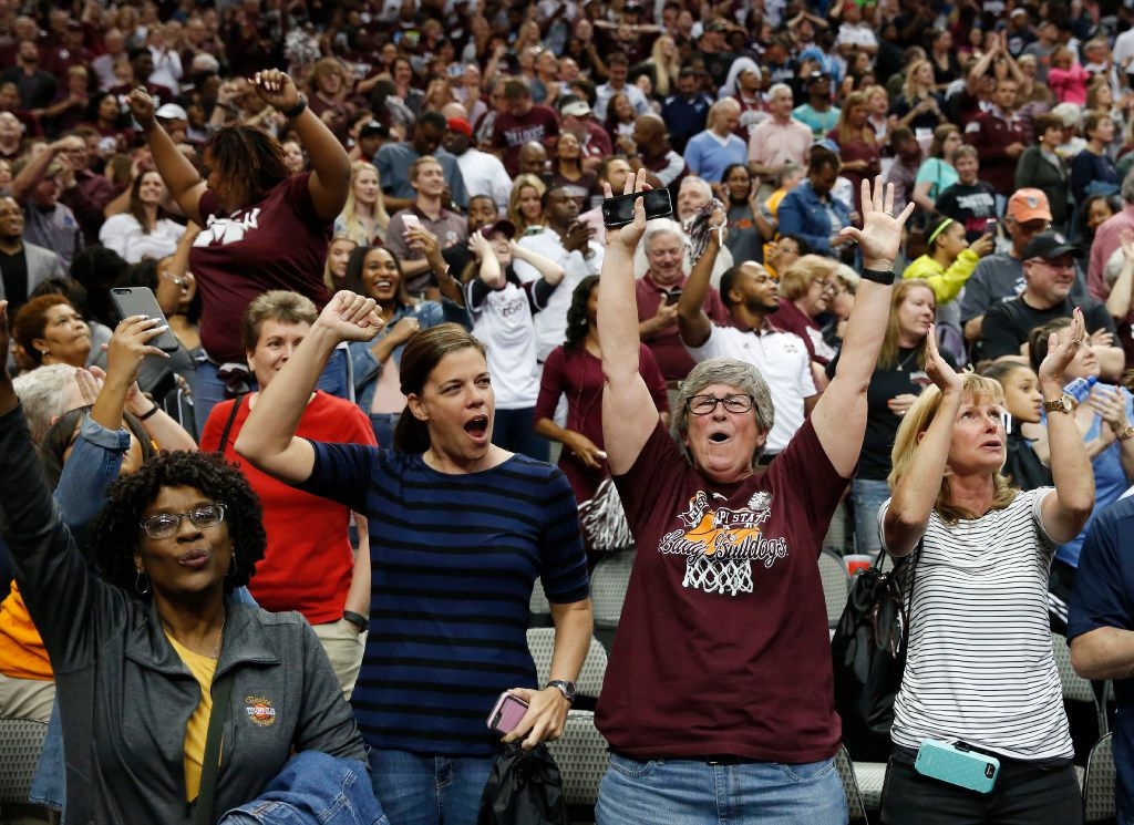 Mississippi State Lady Bulldogs fans celebrate an  overtime victory over the Connecticut Huskies in the NCAA Women's Final Four semifinal game at American Airlines Center in Dallas on Friday, March 31, 2017.  Mississippi State Lady Bulldogs defeated Connecticut Huskies 66-64 to advance. (Vernon Bryant/The Dallas Morning News)