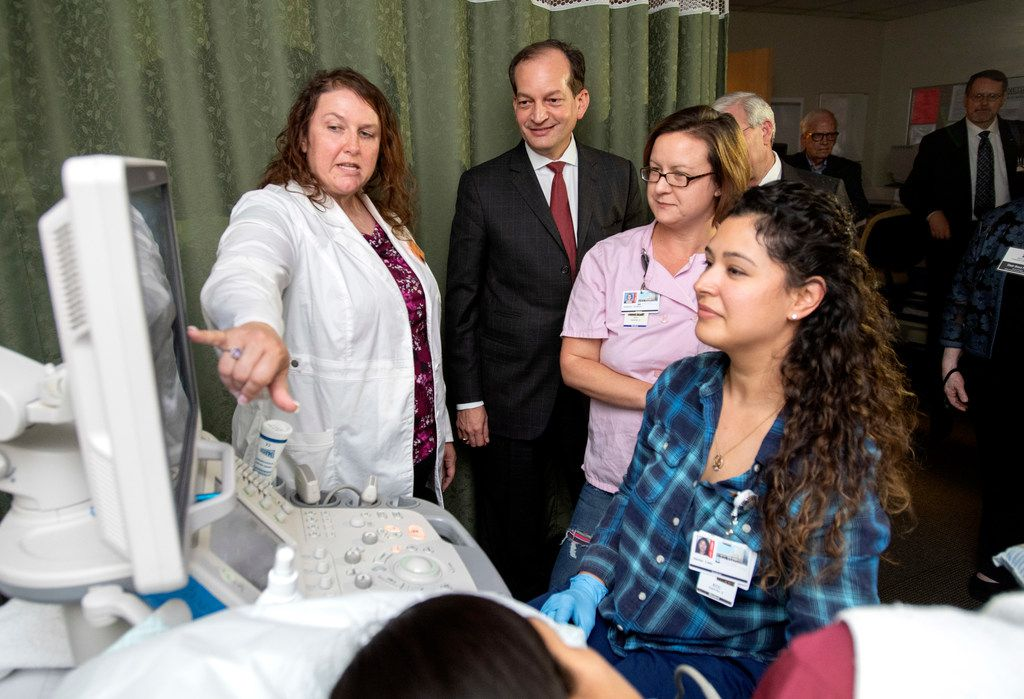 U.S. Labor Secretary Alexander Acosta, center, looks on as echocardiography professor Liberty Cowden, left, and her first year students Kimberly Montoya, center, and Jeanna Luna, right, practice cardiac sonography. Acosta announced a $12 million federal grant that will fund 7,500 new health care apprenticeships through the Dallas County Community College District.