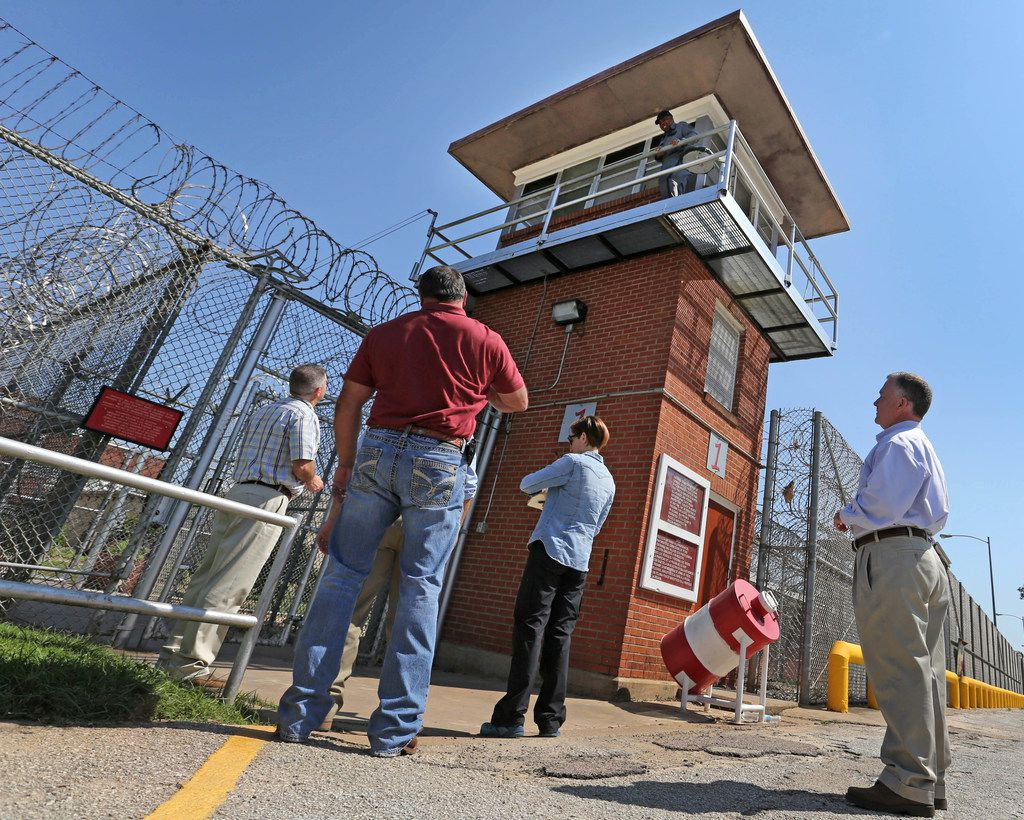 FOR BRANDI SWICEGOOD STORY TDCJ Executive Director Bryan Collier, right, waits with other personnel to enter the Ramsay I Unit during a tour after Hurricane Harvey flooded parts of the Texas Department of Corrections W.F. Ramsey Unit in Rosharon,Texas, photographed on Tuesday, September 12, 2017. (Louis DeLuca/The Dallas Morning News)