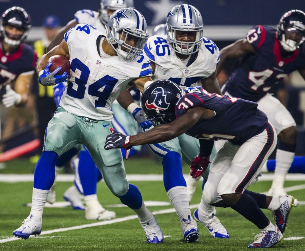 Dallas Cowboys running back Darius Jackson (34) is tackled by Houston Texans defensive back Charles James (31) during the second quarter of their game on Thursday, September 1, 2016 at AT&T Stadium in Arlington, Texas.   (Ashley Landis/The Dallas Morning News)