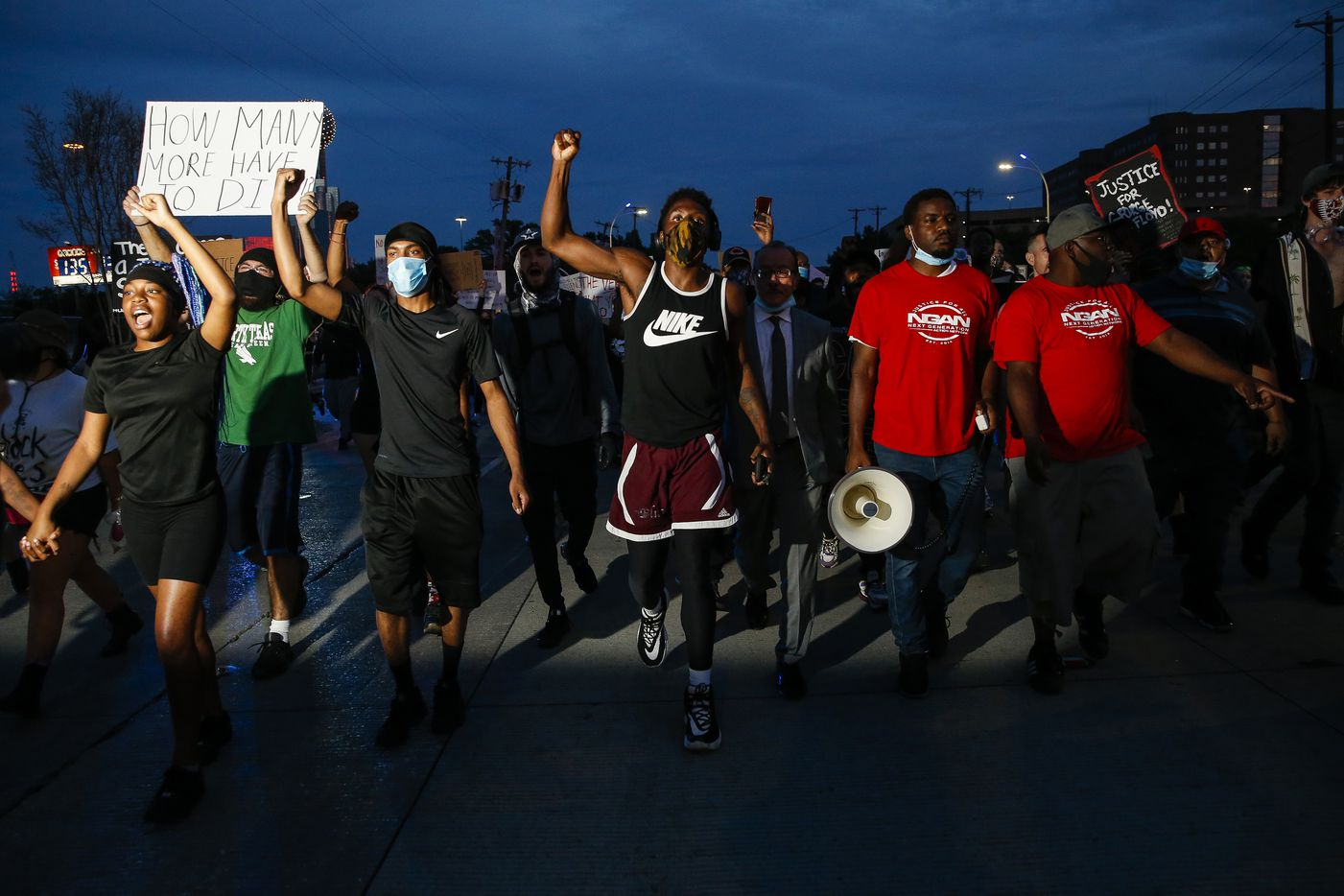 Protesters march to the Margaret Hunt Hill Bridge as they demonstrate against police brutality on Monday, June 1, 2020, in Dallas. Later on, the hundreds of protesters were surrounded and detained by police on the bridge.