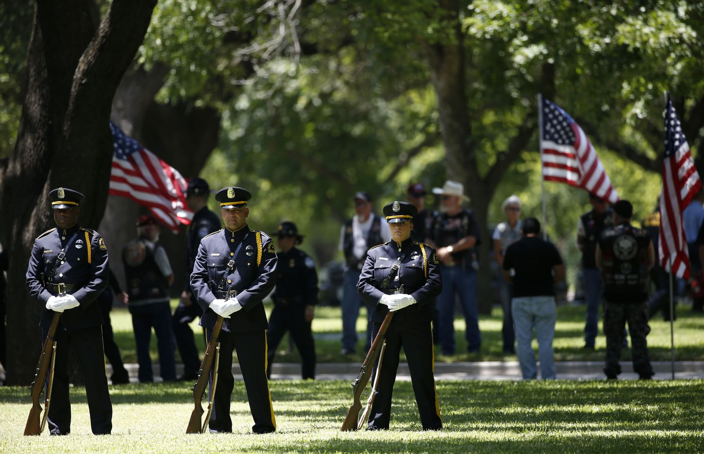 The Honor Guard stands at the burial for fallen Dallas police officer Lorne Ahrens in the Garden of Honor at Restland Funeral Home and Cemetery in Dallas on July 13, 2016. Ahrens and four other officers were gunned down during an ambush on police in downtown Dallas.