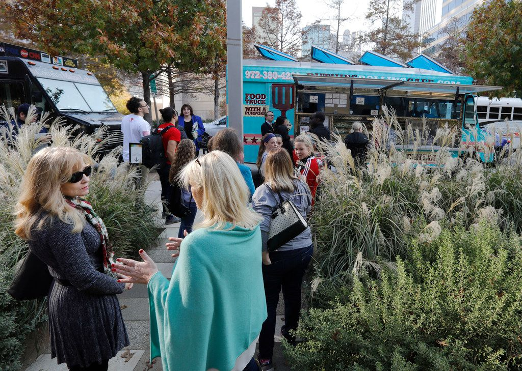 People wait in line to order from Ruthie's Rolling Cafe food truck at Klyde Warren Park.