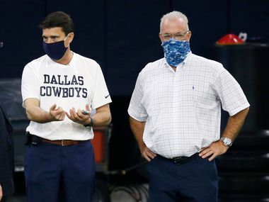 Dallas Cowboys owner and general manager Jerry Jones talks with Dallas Cowboys athletic trainer Jim Maurer and Dallas Cowboys executive vice president Stephen JOnes during training camp at the Dallas Cowboys headquarters at The Star in Frisco, Texas on Monday, August 24, 2020.