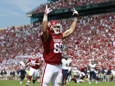 Tight end Grant Calcaterra #80 of the Oklahoma Sooners celebrates a touchdown against the UTEP Miners at Gaylord Family Oklahoma Memorial Stadium on September 2, 2017 in Norman, Oklahoma. Oklahoma defeated UTEP 56-7.