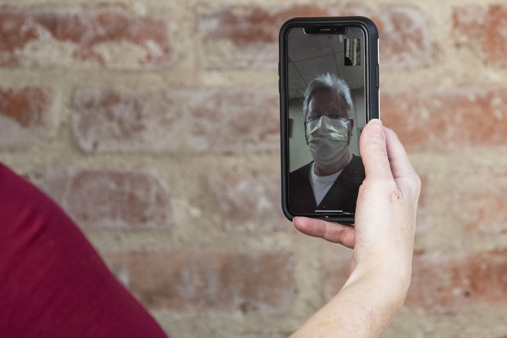 Jackie, Michael's wife, speaks with Dr. Gary Weinstein of Texas Health Presbyterian Hospital Dallas during a FaceTime session.
