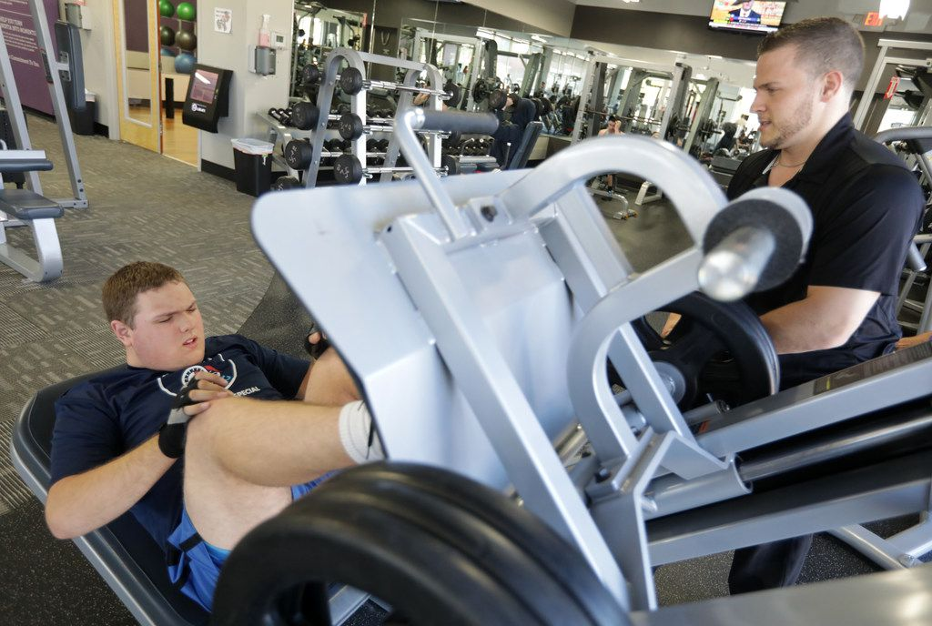 Robert Hise, 17, ( left) and Daniel Stein with Special Strong exercise at Anytime Fitness in McKinney. Robert is autistic. Working out has helped him focus and led to fewer meltdowns.