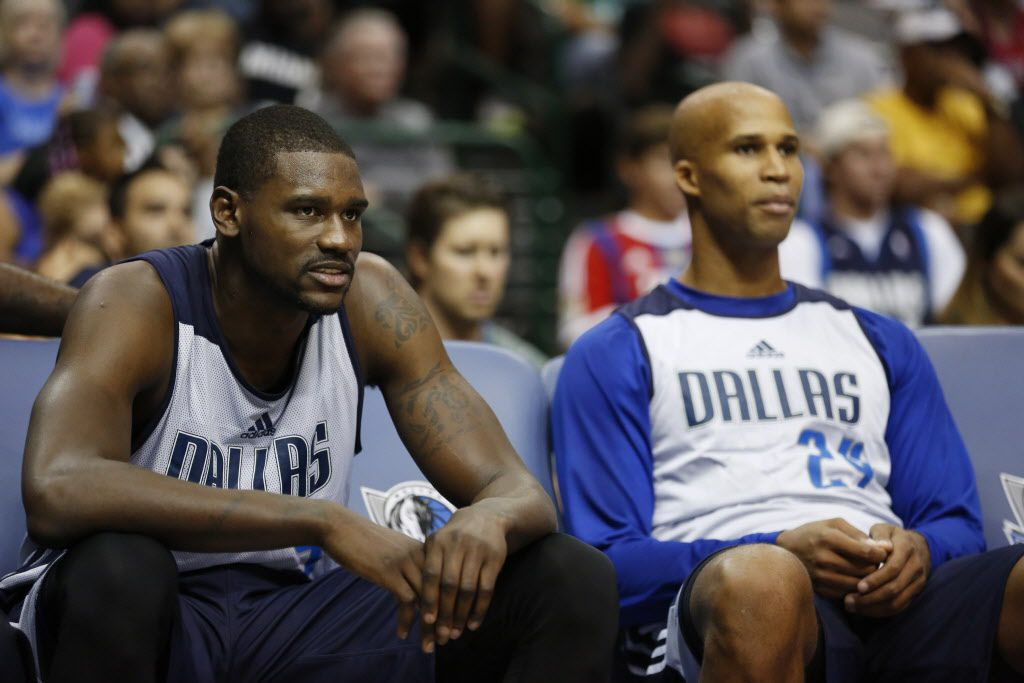 Dallas Mavericks center Bernard James (5) and forward Richard Jefferson (24) watch from the bench during a team scrimmage at the Dallas Mavericks Fan Jam at the American Airlines Center in Dallas Saturday October 4, 2014.