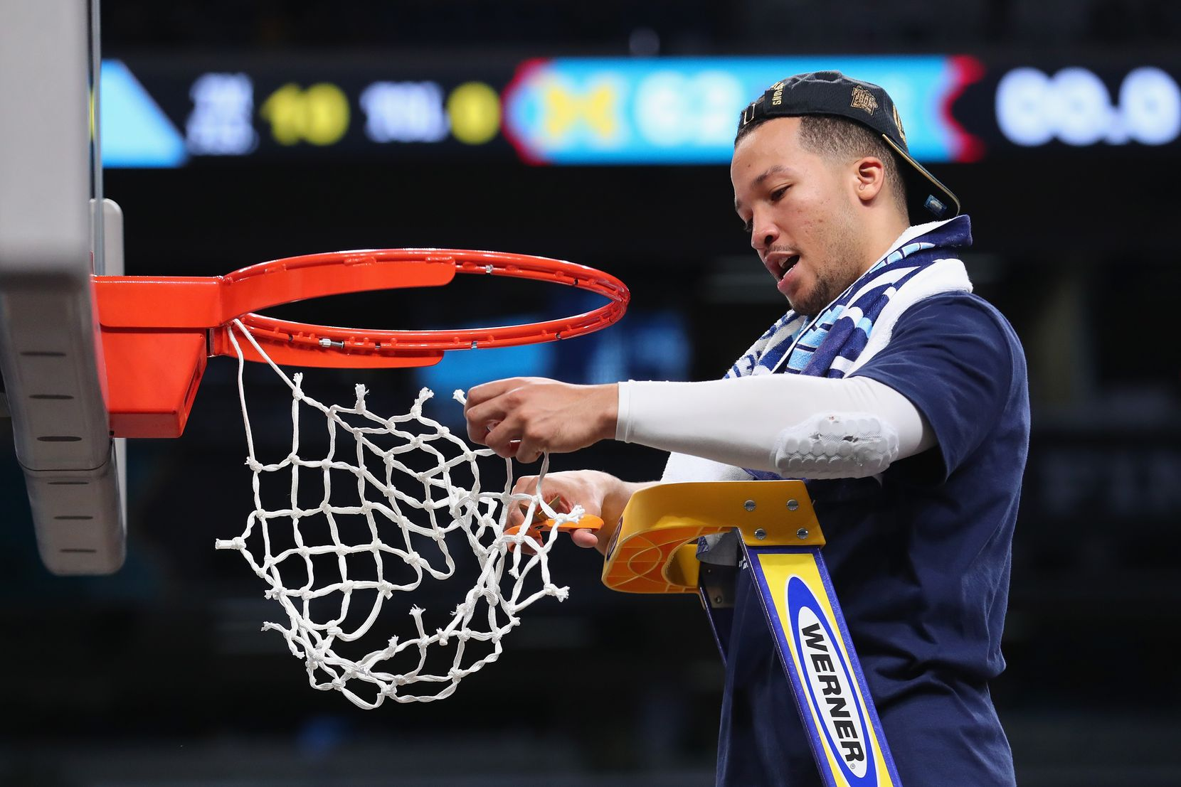 SAN ANTONIO, TX - APRIL 02:  Jalen Brunson #1 of the Villanova Wildcats cuts down the net after defeating the Michigan Wolverines during the 2018 NCAA Men's Final Four National Championship game at the Alamodome on April 2, 2018 in San Antonio, Texas.  Villanova defeated Michigan 79-62.  (Photo by Tom Pennington/Getty Images)