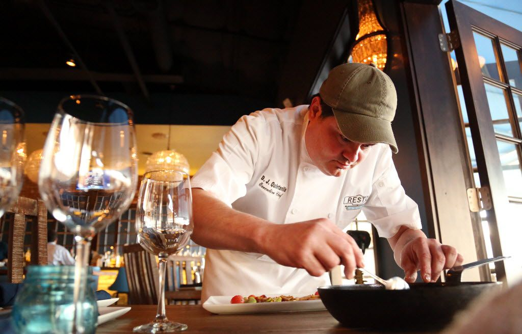 Chef D.J. Quintanilla at Resto Gastro Bistro at Trinity Groves, prepares a dish for a photo shoot at the restaurant in Dallas, TX on March 20, 2014. (Kye R. Lee/The Dallas Morning News)