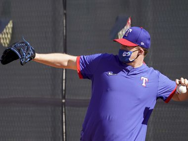 Texas Rangers pitcher Wes Benjamin plays catch during a spring training workout at the team's training facility on Saturday, Feb. 27, 2021, in Surprise, Ariz.