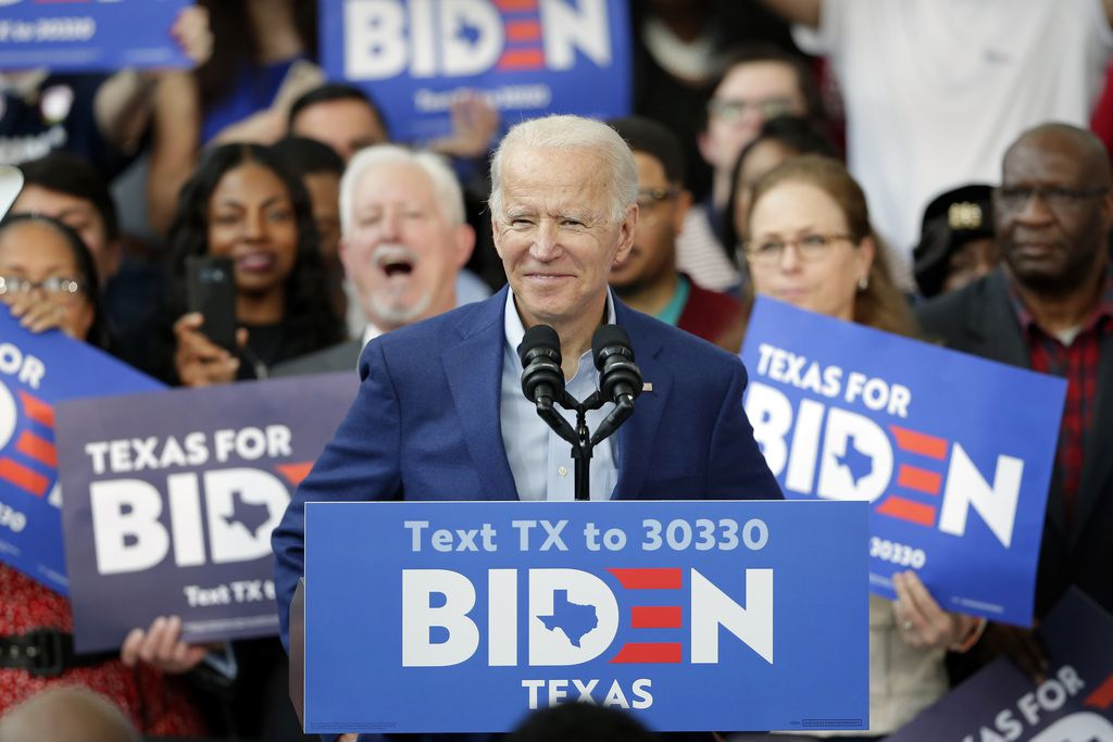 Several Texans are part of 43 Alumni for Biden, a group of former George W. Bush administration officials who backing Democrat Joe Biden, seen here at a rally in Texas in early March. (AP Photo/Michael Wyke)
