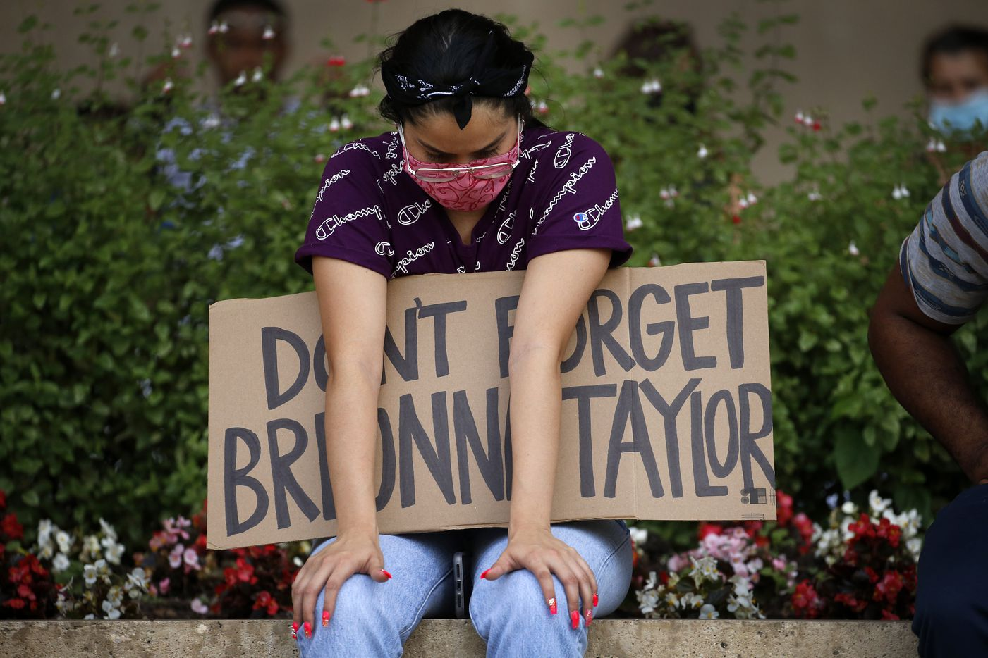 A protestor supporting Breonna Taylor came to listen to a Black Lives Matters rally at Dallas City Hall before marching through downtown Dallas to Dealey Plaza, Wednesday, June 3, 2020. (Tom Fox/The Dallas Morning News)