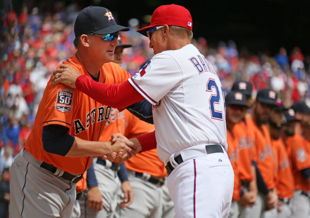 Texas Rangers manager Jeff Banister (28) shakes hands with Houston Astros manager A.J. Hinch (14) during the pre game ceremonies before during the Houston Astros vs. Texas Rangers Major League Baseball home opener on Friday, April 10, 2015. (Louis DeLuca/The Dallas Morning News)
