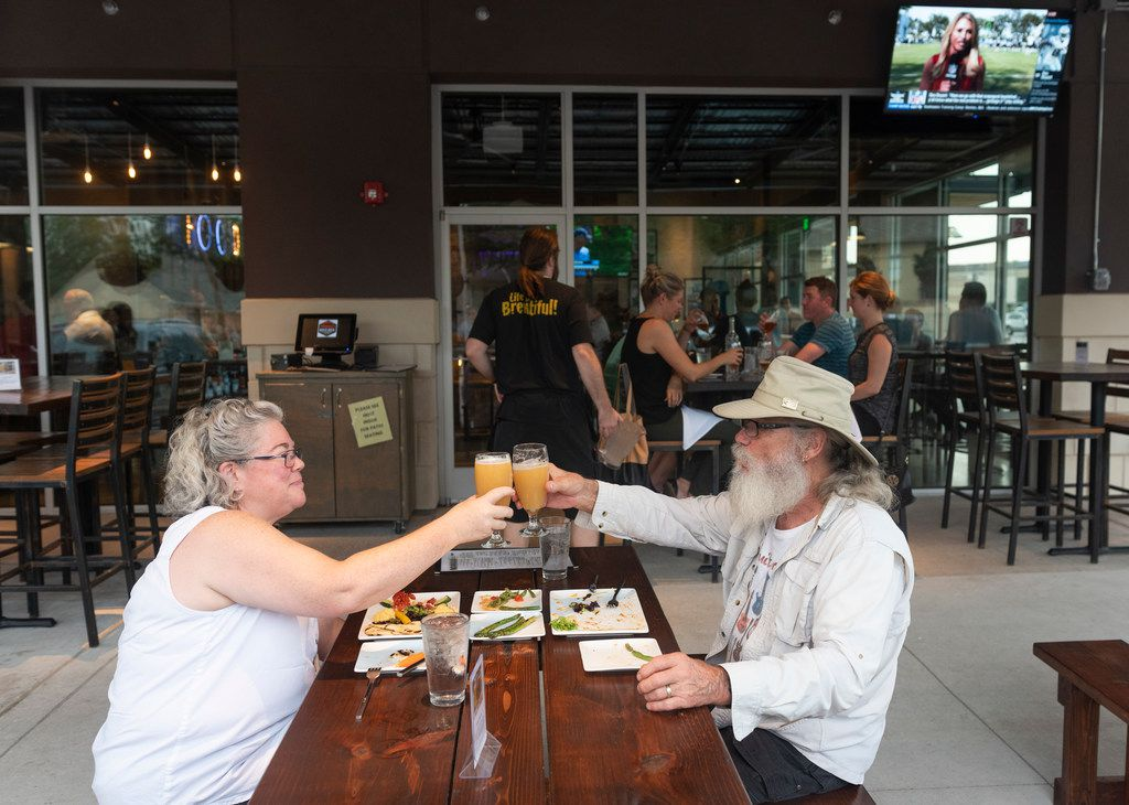Mimi Bullen, left, and her husband Dave Bullen enjoy dinner on the patio at White Rock Alehouse and Brewery.