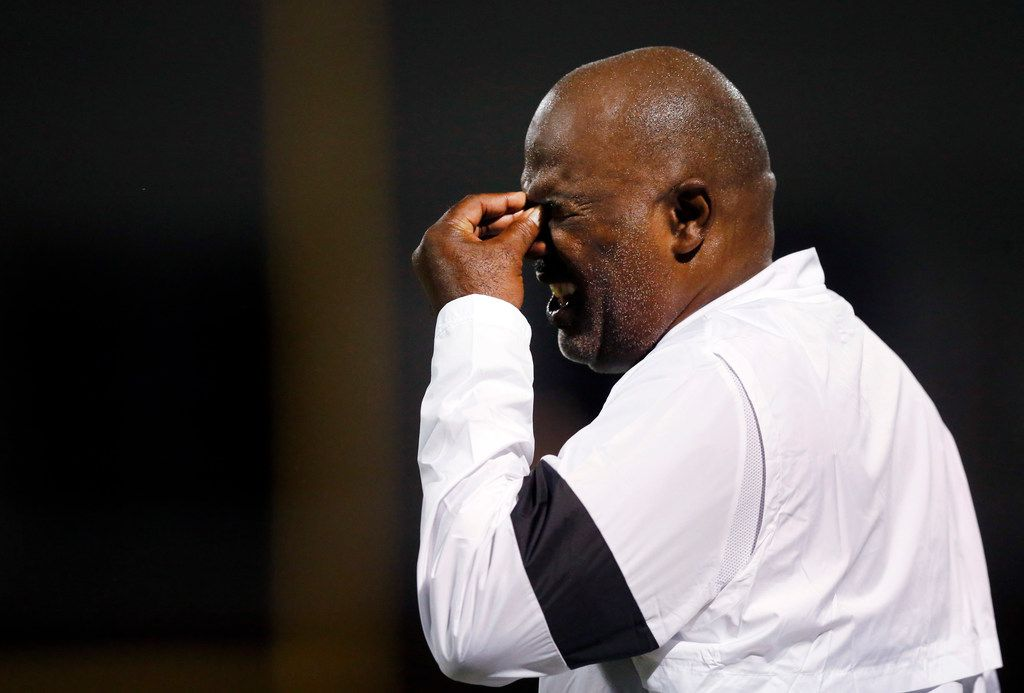 Duncanville head coach Reginald Samples winces as he watches his players performance against Lancaster at Beverly D. Humphrey Tiger Stadium in Lancaster Texas, Friday, August 30, 2019.